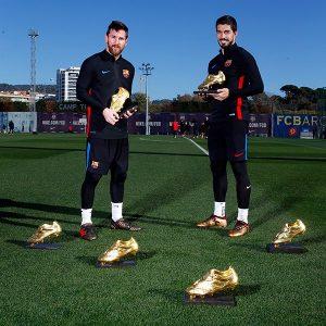 Messi e Suárez com suas Chuteiras de Ouro